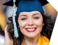 UCO Student in cap and gown smiling