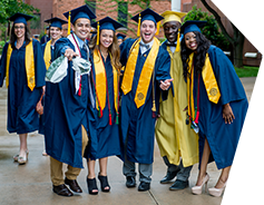 Graduates in group wearing caps and gown