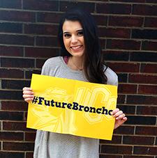 UCO student holding #FutureBroncho sigh