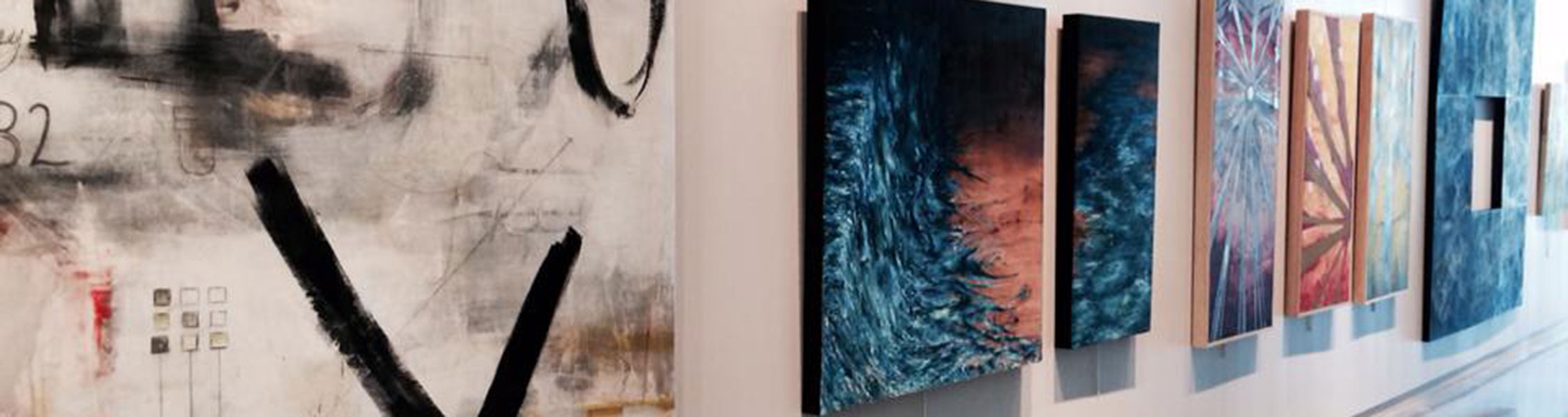 photo of art hanging on the wall in the Melton Gallery