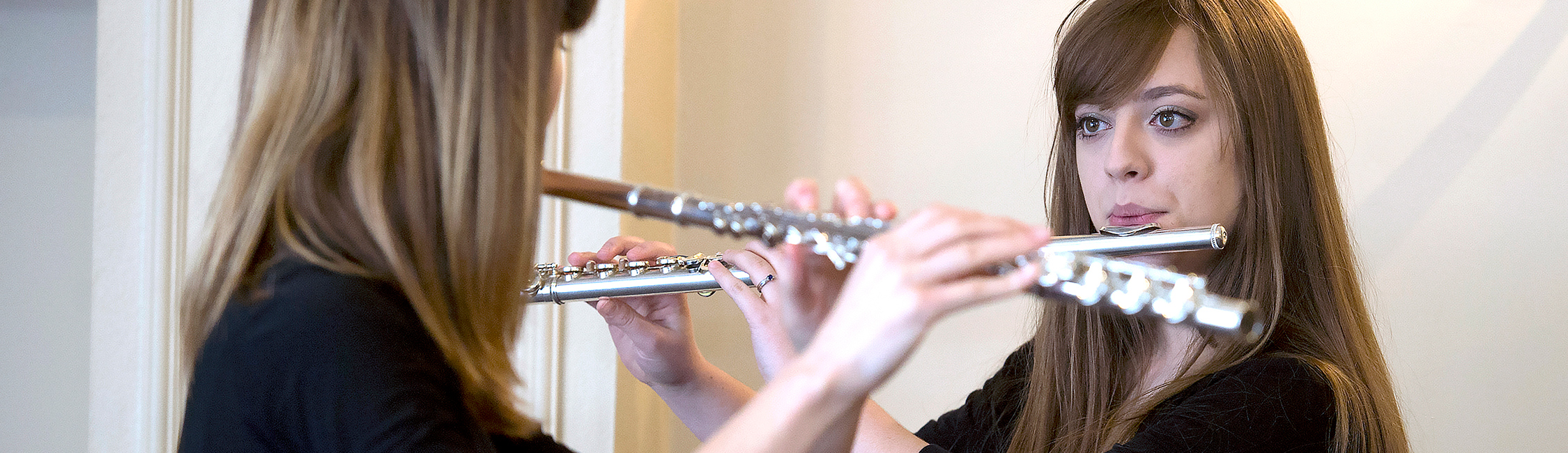 two students practicing flute