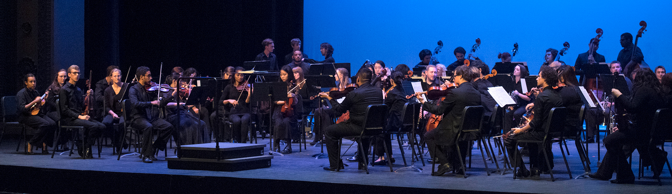chamber orchestra performing on stage