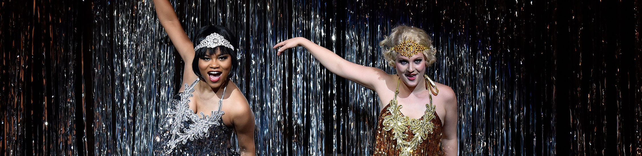 two students performing in sparkly dresses