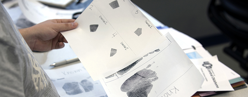photo of a student analyzing forensic print data