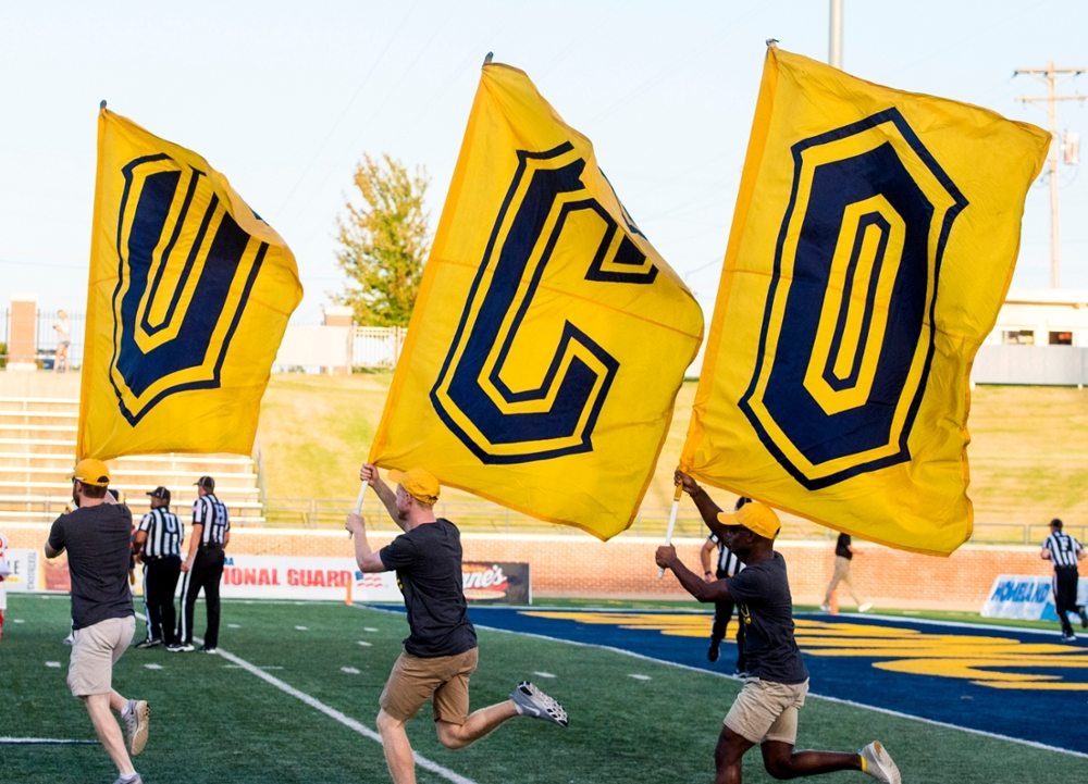 UCO flags at football game