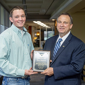 Townsend receives an award from UCO Provost Barthell