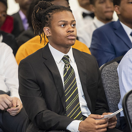 photo of student listening to a presentation