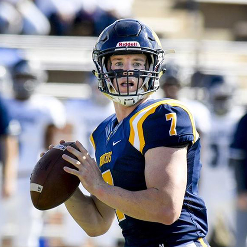 photo of uco quarterback holding a football