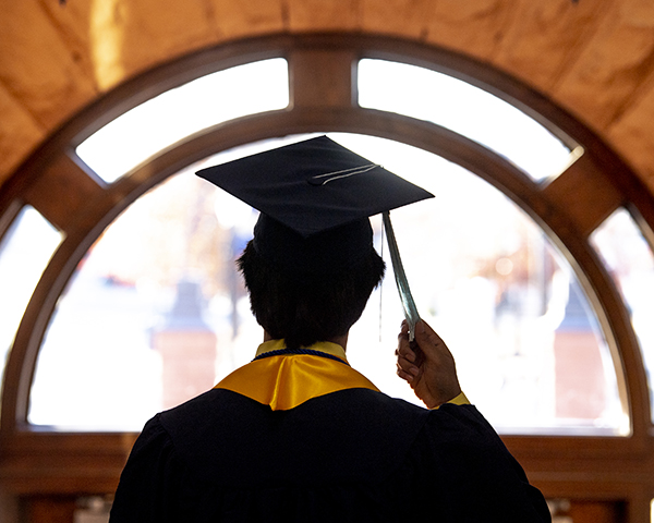 photo of uco graduate looking out window