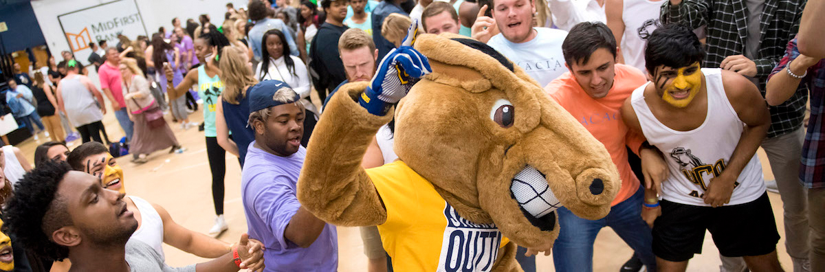 Buddy Broncho with Students at an event