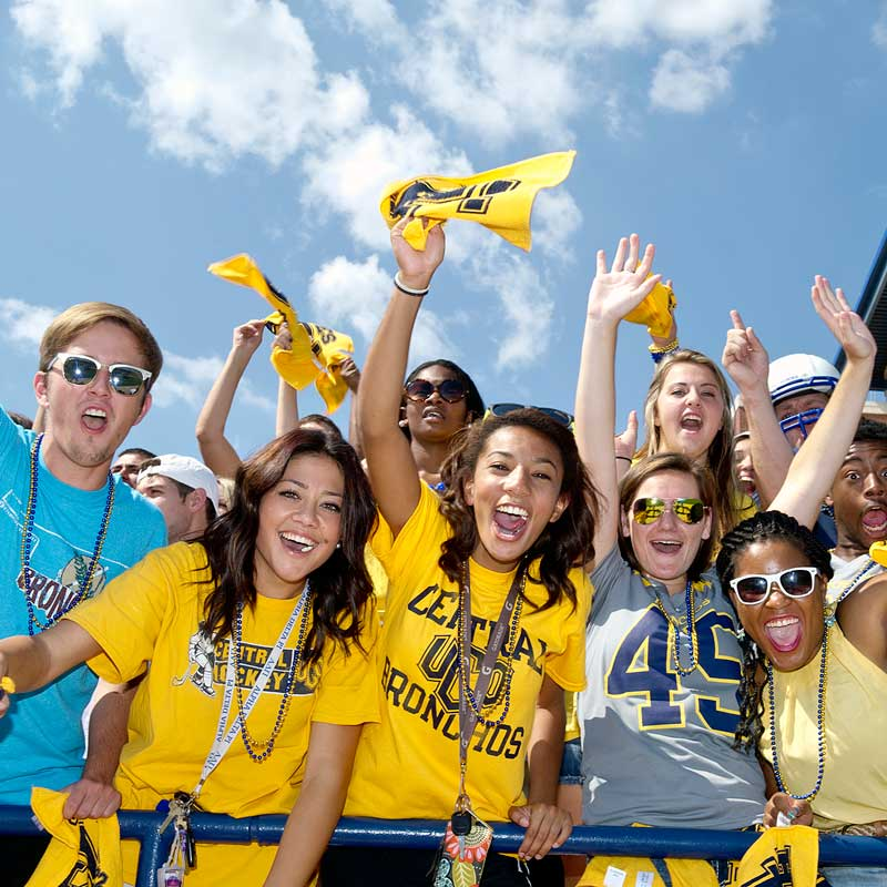 smiling students wearing Broncho attire