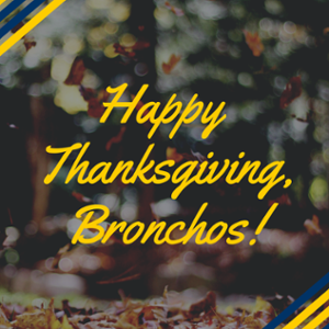 "text saying ""Happy Thanksgiving, Bronchos!"" on a fall foliage background"