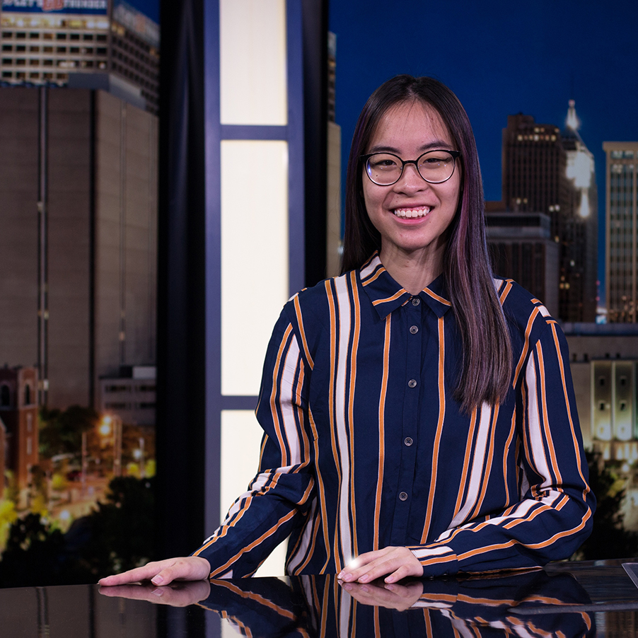 Student sitting at an anchor desk