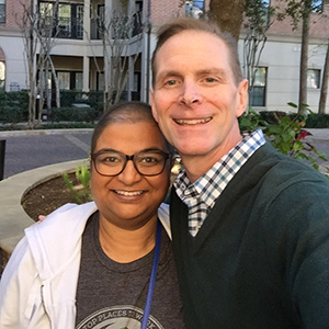 Susan Varghese Thomas and Jeff York post outside of Paycom in Oklahoma City