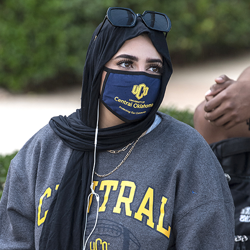 photo of uco student wearing uco mask