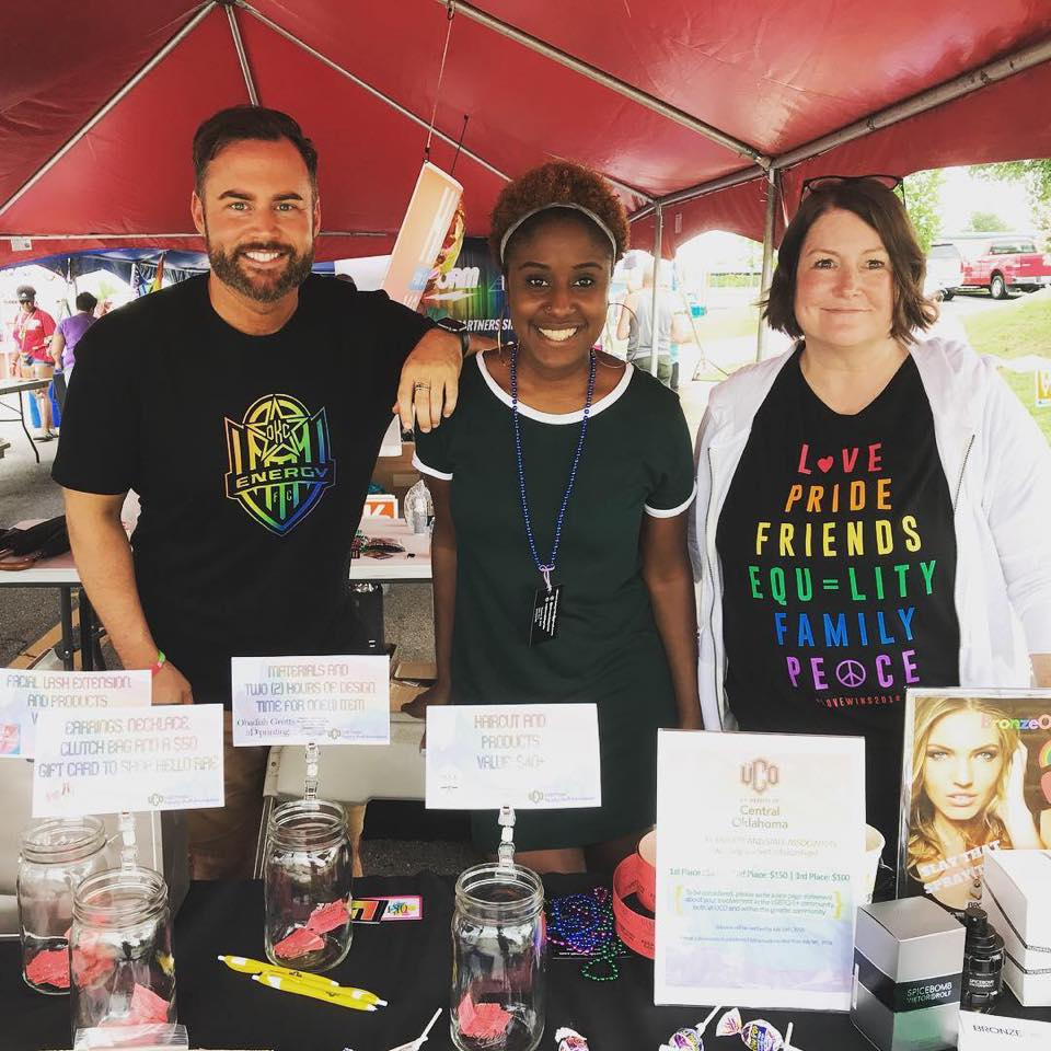 UCO employees working the LGBTQIA information booth at a Pride event