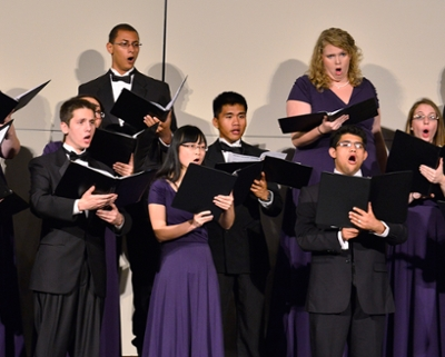 men and women singing in a choir