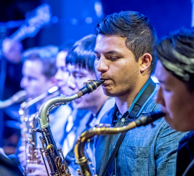 man playing saxophone in a group