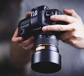 student holding a camera