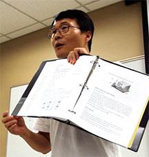 man holding binder