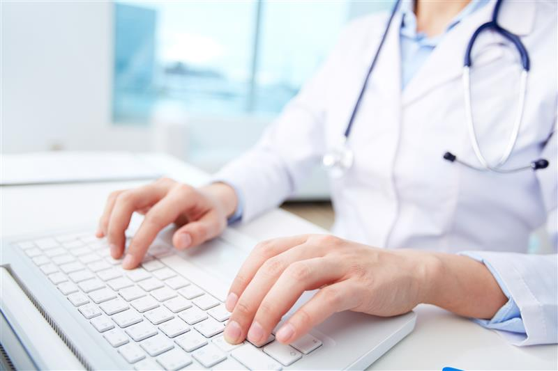 Online nursing student with keyboard