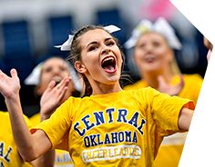 Excited UCO Cheerleader in Yellow Central Shirt