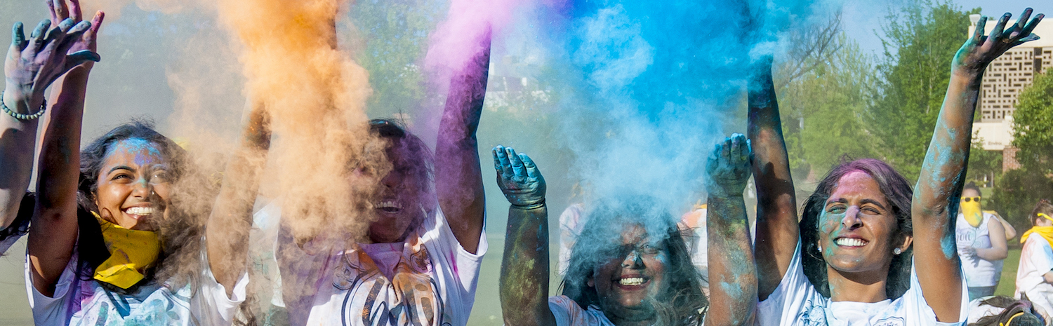 students at holi with colored powder