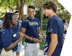 Female Orientation Leader Giving Two Students Directions